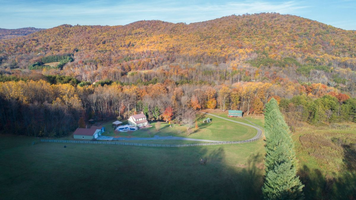 15 acres, a barn, detached garage and pool!